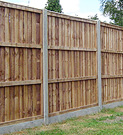 Panel fence with concrete posts & gravel board.