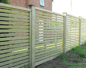 Horizontal spaced panel fencing