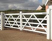 Double farm gates painted white.